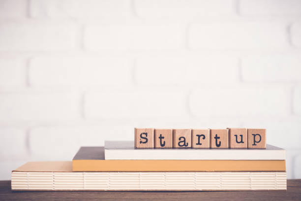 The word Startup and blank space background. stock photo