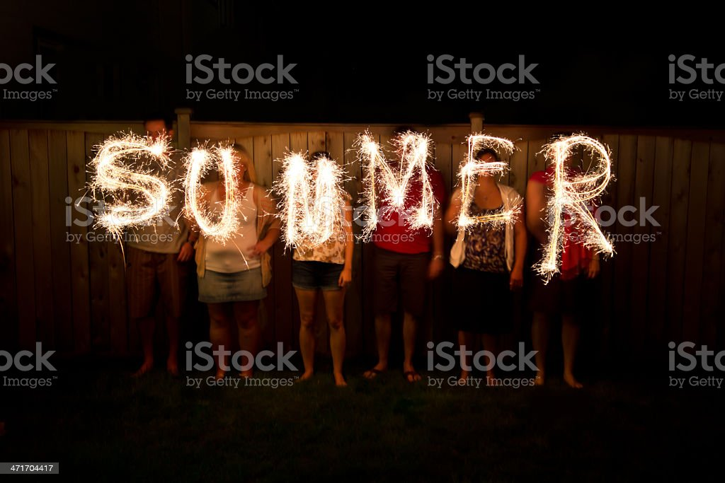 The word Summer in sparklers time lapse photography stock photo