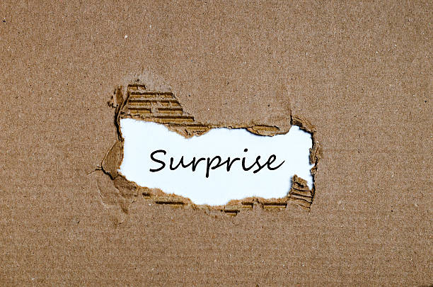 the word surprise appearing behind torn paper - disconcert stock pictures, royalty-free photos & images