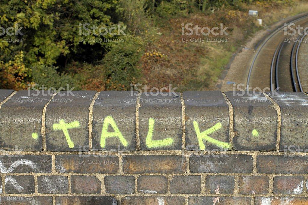 Talk graffiti on a bridge over railway lines stock photo