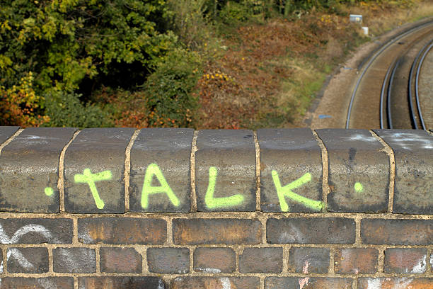 talk graffiti on a bridge over railway lines - whiteway graffiti stock photos and pictures