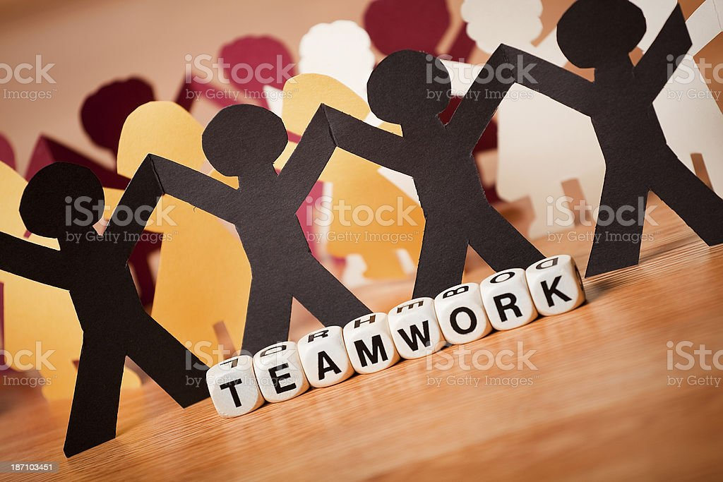 The Word TEAMWORK Spelled In Letter Cubes With Paper People royalty-free stock photo