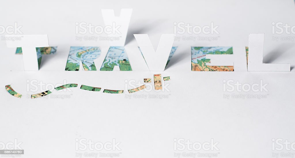 The word travel cut from paper, stock photo