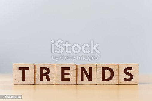 istock The word TREND on wooden cube block. This year's trend concept 1133383640