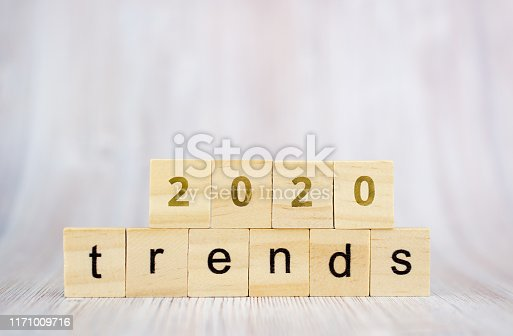 The word trends and 2020 on wooden cube block. 2020 trend concept.