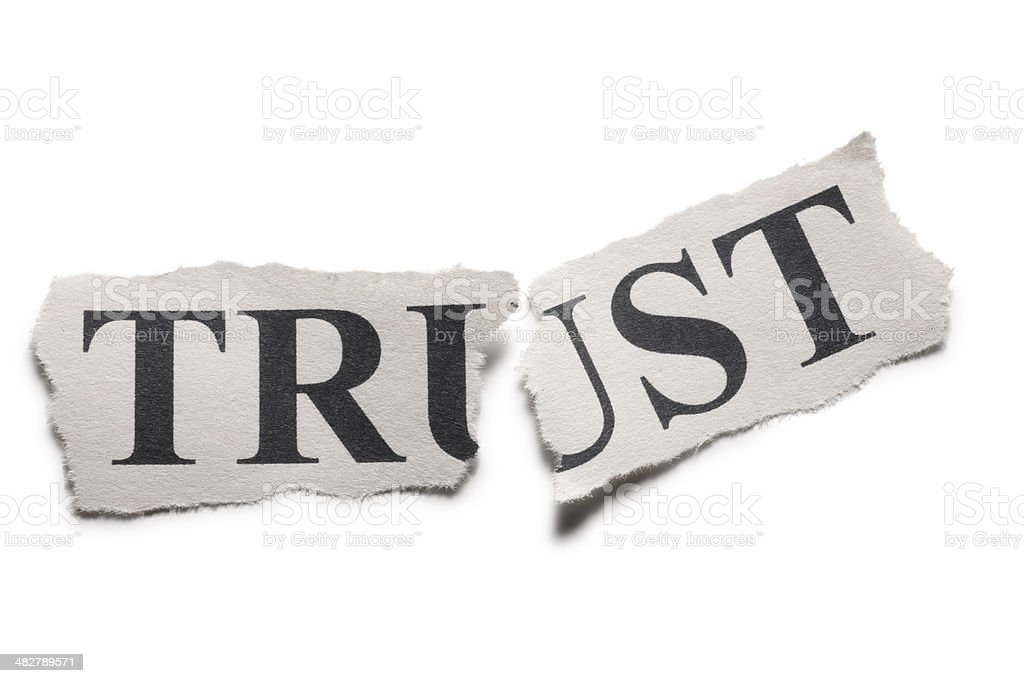 The word trust printed on paper torn in half stock photo