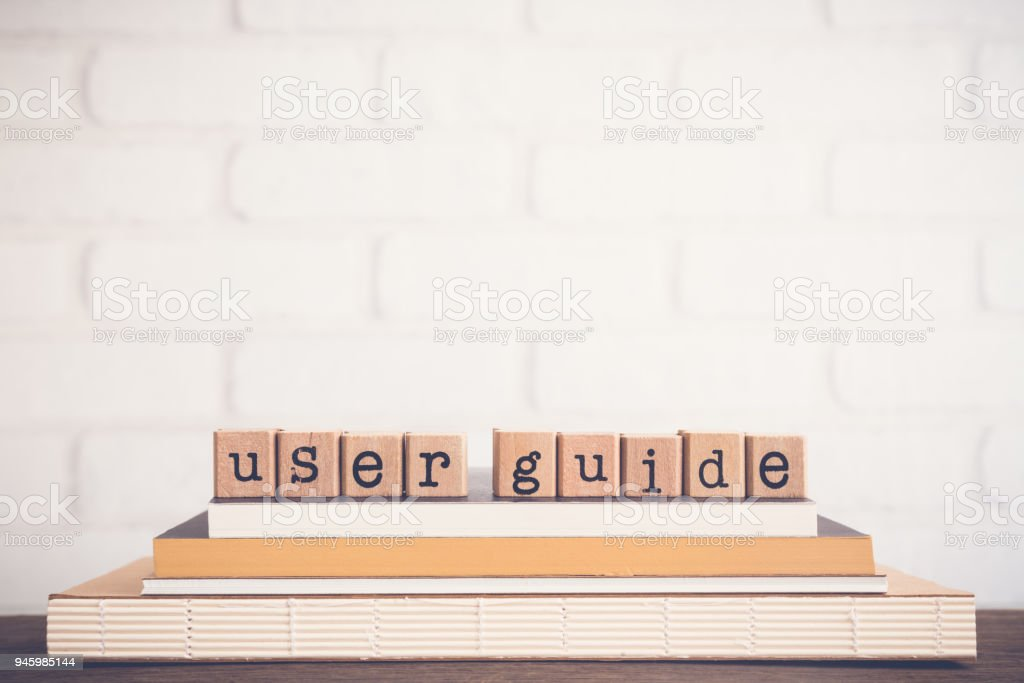 The word User guide and copy space background. stock photo
