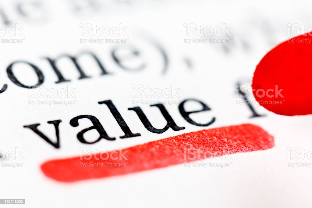 The word 'value' underscored in red in document stock photo