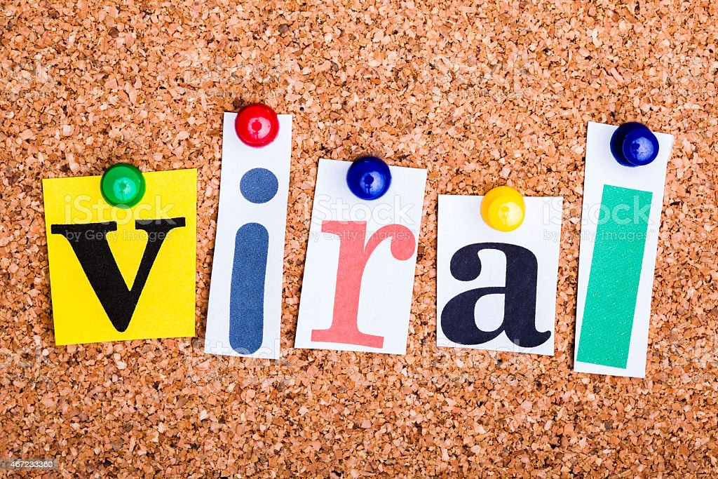 The word viral in cut out magazine letters stock photo
