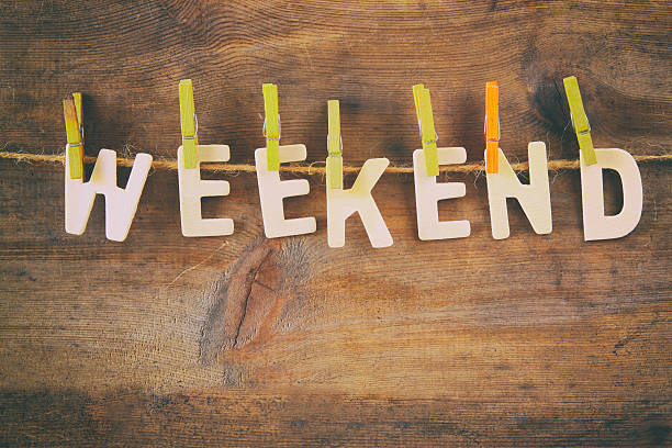 The word WEEKEND made from wooden letters stock photo