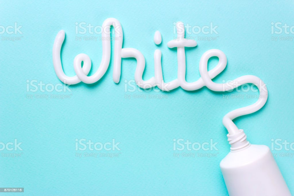 The word white is from the toothpaste. Tube for cleaning teeth and whitening. Copy space for text stock photo
