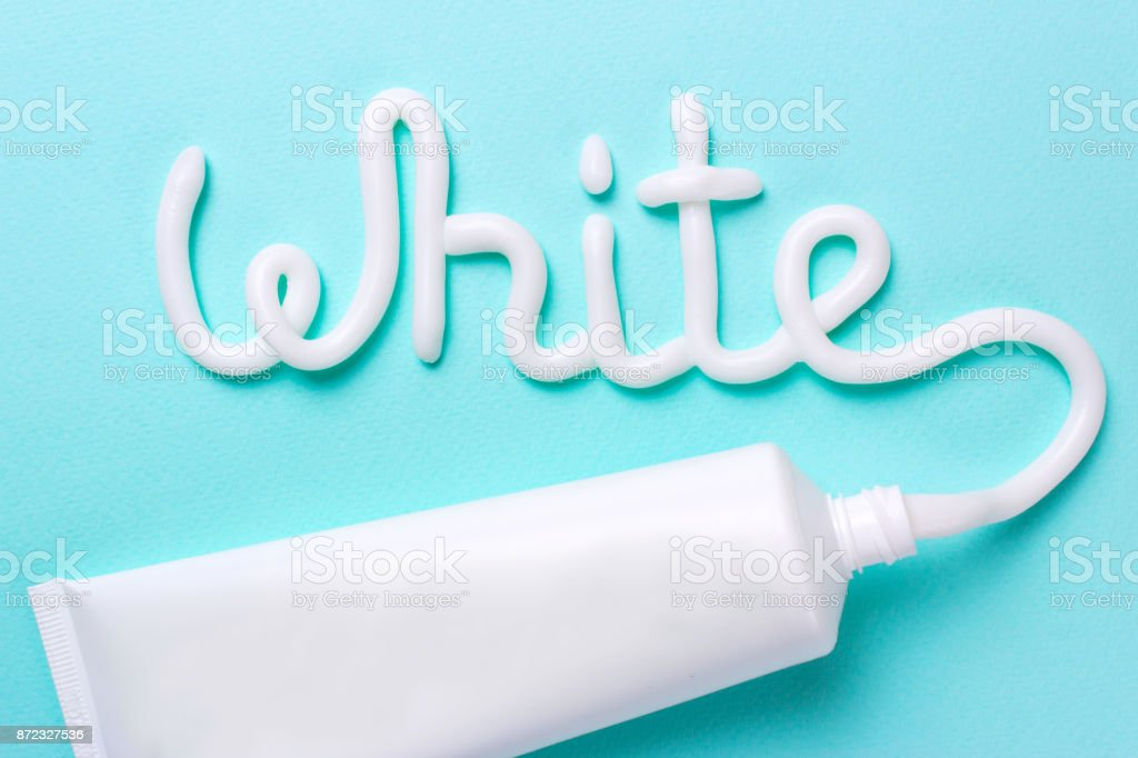 The word white is from the toothpaste. Tube for cleaning teeth and whitening stock photo