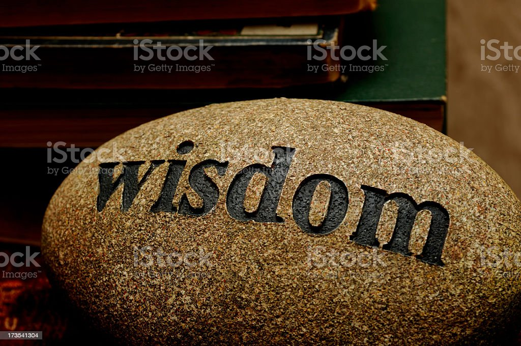 The word wisdom etched into a stone royalty-free stock photo