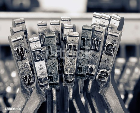 the word  writing with old typwriter keys  monochrome