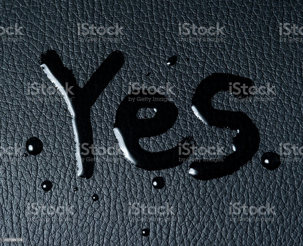 The word 'yes' on black skin royalty-free stock photo