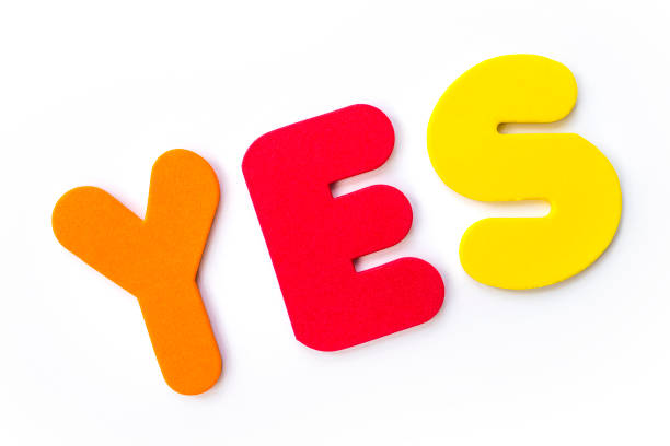 The Word YES YES spelt out with coloured letters. Amen stock pictures, royalty-free photos & images