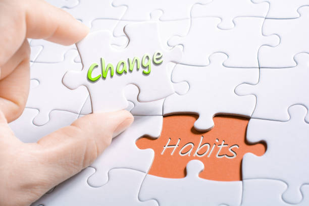 The Words Change And Habits In Missing Piece Jigsaw Puzzle The Words Change And Habits In A Missing Piece Jigsaw Puzzle stop single word stock pictures, royalty-free photos & images