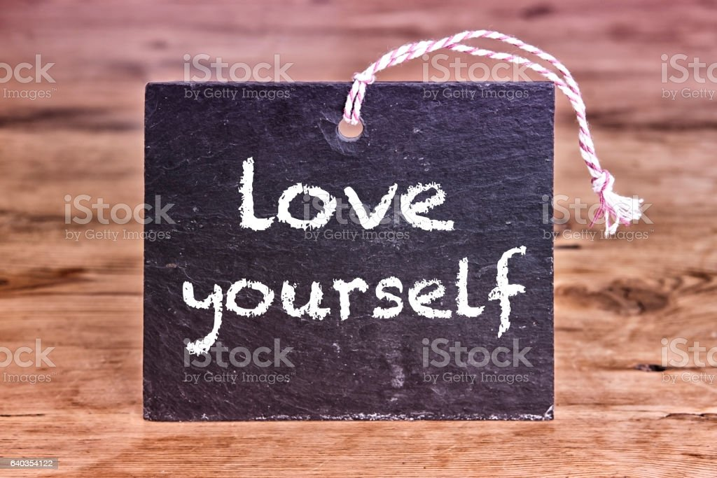 the words Love Yourself written on chalk board stock photo