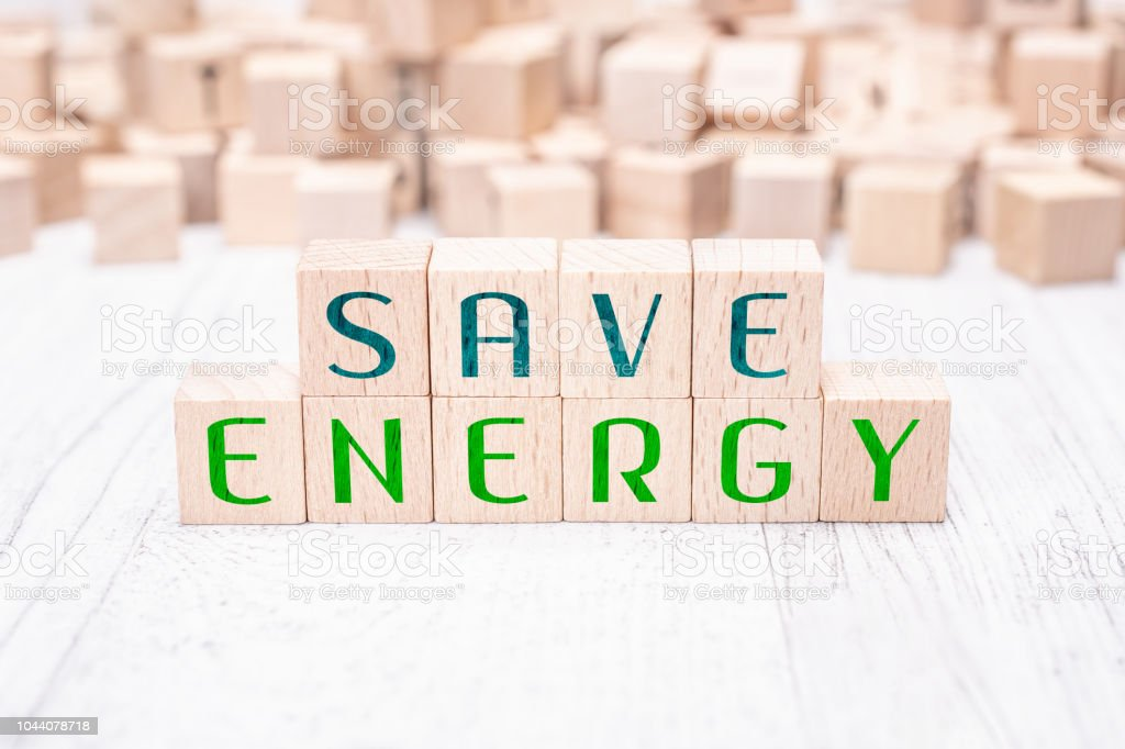 The Words Save Energy Formed By Wooden Blocks On White Table