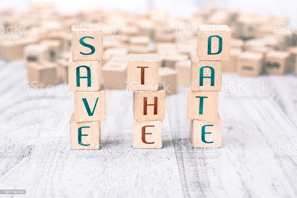 Words Save The Date Formed By Wooden Blocks On A White Table