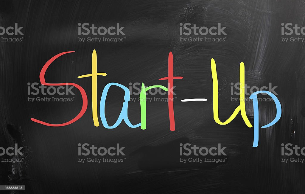 The words start up written in color on a black background stock photo