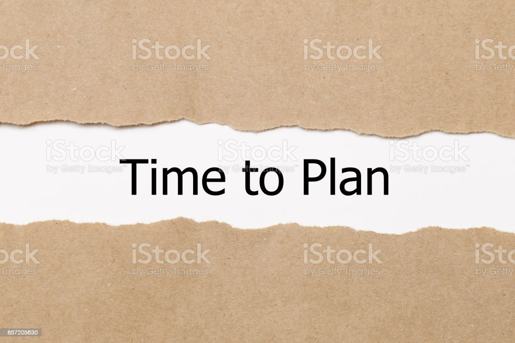 The words time to plan appearing behind torn paper stock photo