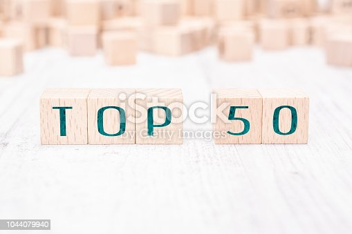 istock The Words Top 50 Formed By Wooden Blocks On A White Table 1044079940