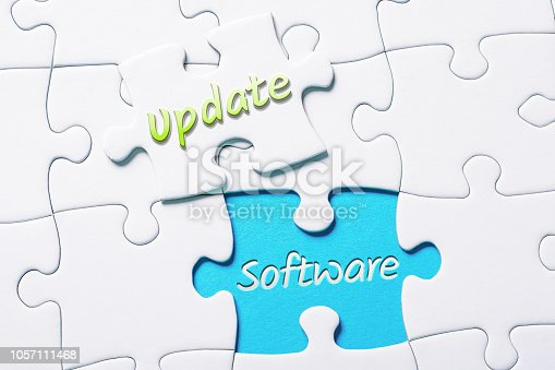 istock The Words Update And Software In Missing Piece Jigsaw Puzzle 1057111468