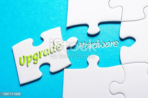 istock The Words Upgrade And Hardware In Missing Piece Jigsaw Puzzle 1057111326