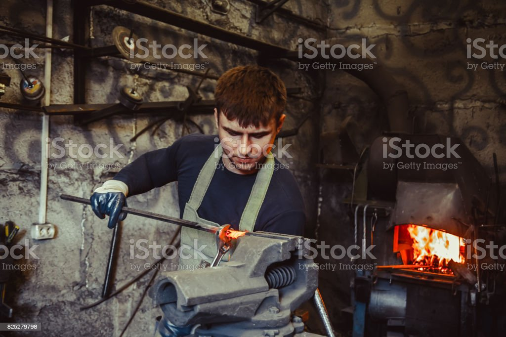 The worker grips the vice stock photo