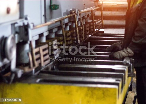 the worker is engaged in cutting of metal on the production automatic machine tool, metal cutting, close-up