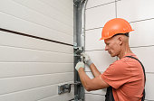 istock The worker is installing lift gates in the garage. 1290763964