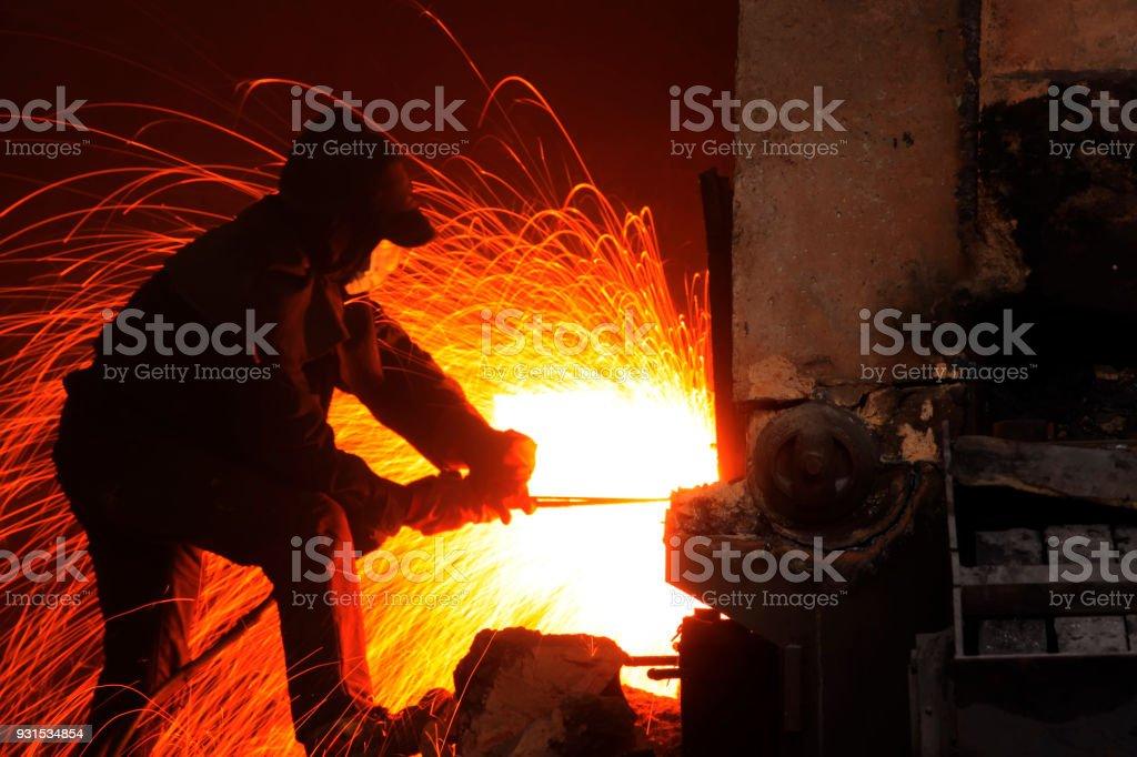 The workshop welder cuts metal stock photo