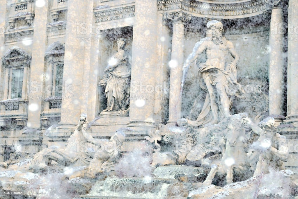The world famous Trevi fountain in Rome during a snow cyclone. stock photo