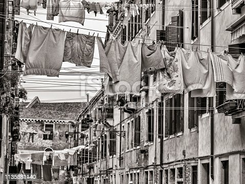 Rustic windows and hanging laundry along the alleyways of Venice