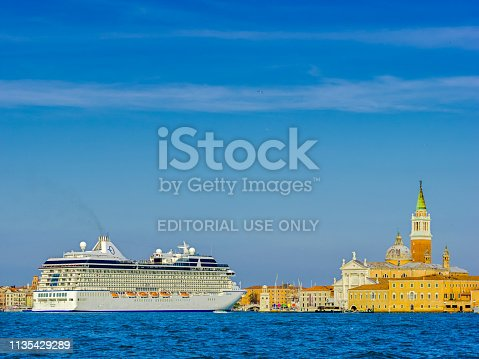 Venice Italy on October 05, 2015: Cruise ship leaving Venice harbor at the end of the day