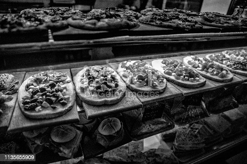 Selection of toasts and pizzas at a restaurant counter on the island of Burano off Venice