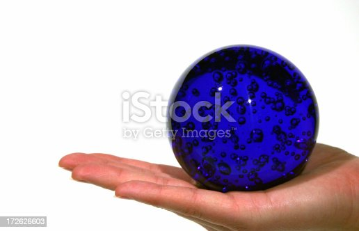 Great for business concepts. A hand holding a shiny blue globe.