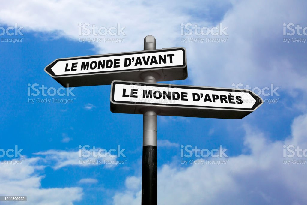 The world of before vs The world of after - French direction sign Two direction signs, one pointing left and the other one, pointing right, with written in them in French : Le monde d'avant / Le monde d'après, meaning in English: The world of before / The world of after. Arrow Symbol Stock Photo