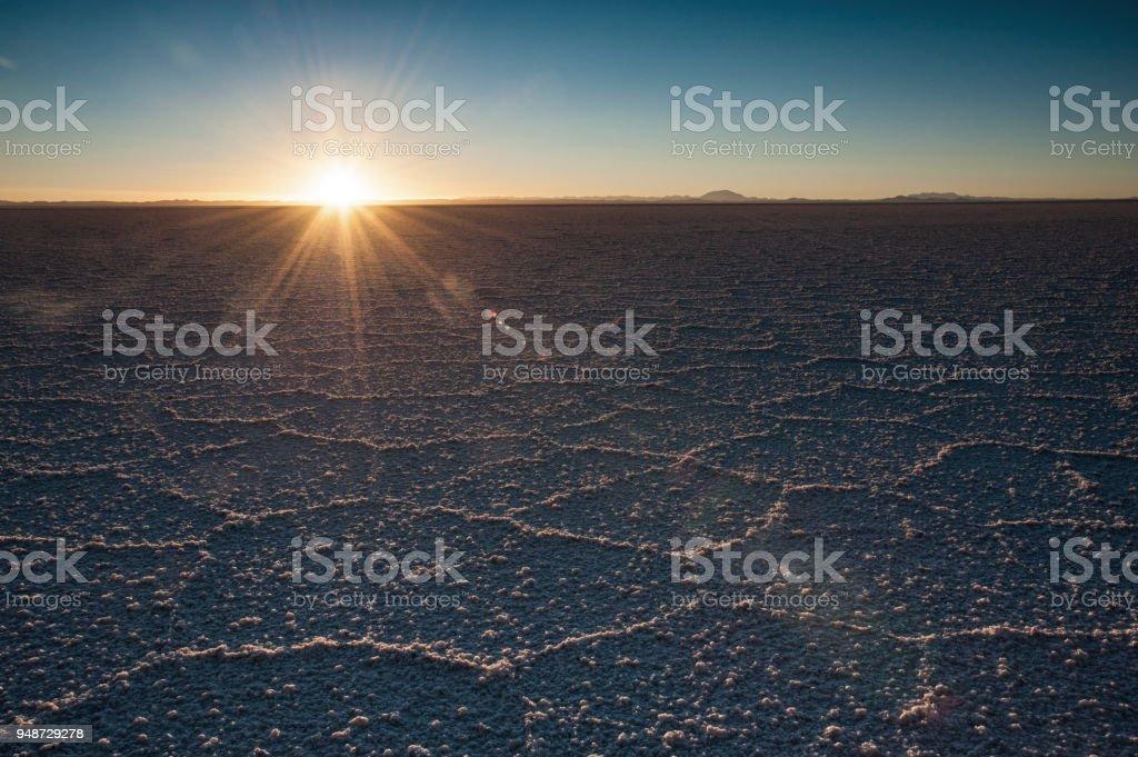 The world's largest salt flat, Salar de Uyuni in Bolivia, photographed at sunrise stock photo