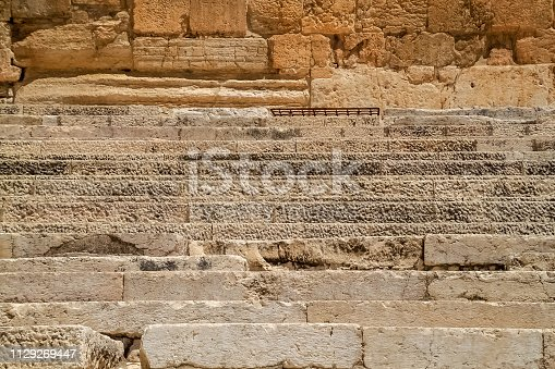The worn steps cut into the bedrock of Mount Moriah as it ascends to the Temple Mount in front of the Double Gate in the Ophel. Jerusalem, Israel