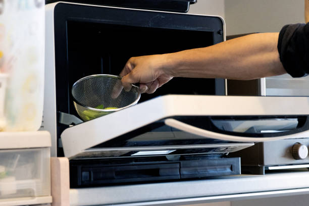 The wrong way to use the microwave stock photo