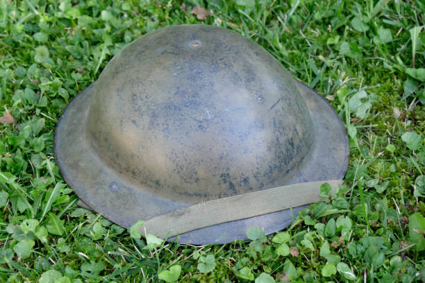 the wwii british helmet on the grass the wwii british helmet on the grass dieppe france stock pictures, royalty-free photos & images