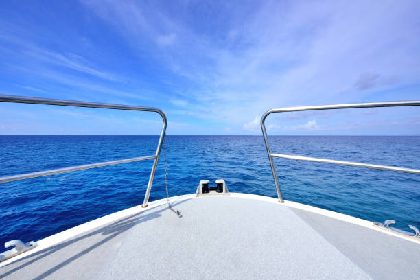 the yacht sailing at sea - yacht front view stock photos and pictures