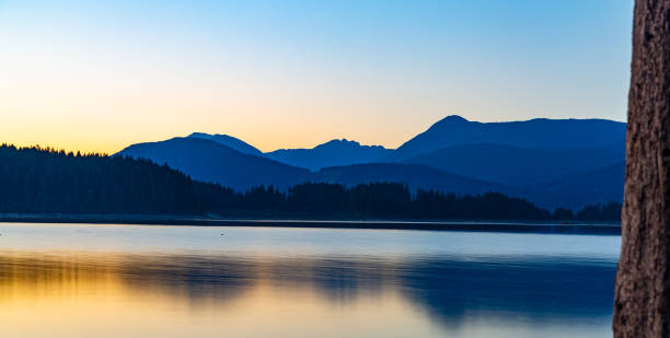 The yellow and blue sunset at Lois Lake stock photo