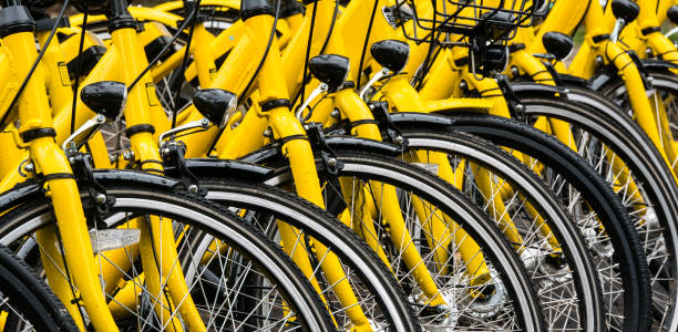 The yellow bike in bike sharing project Under the Government's policies in developing the Smart city of Phuket stock photo
