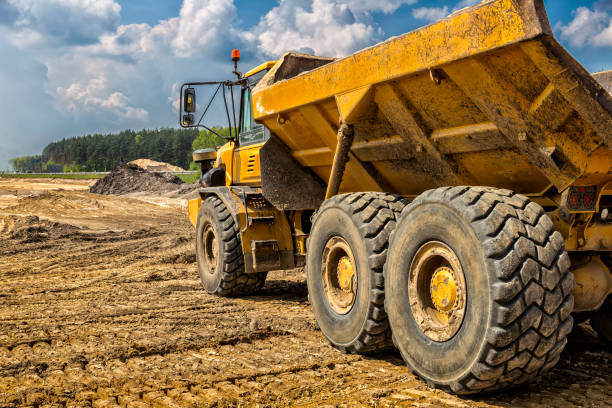 The yellow dump truck on the construction of highway S6, Goleniów, Poland stock photo