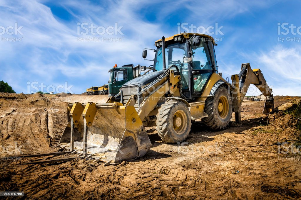 The yellow eart mover on the construction of highway, Poland stock photo