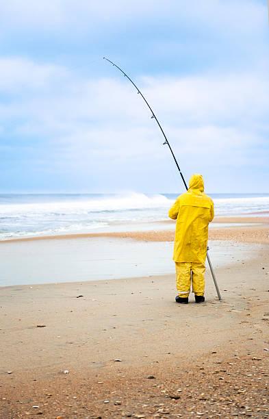 The yellow fisherman stock photo