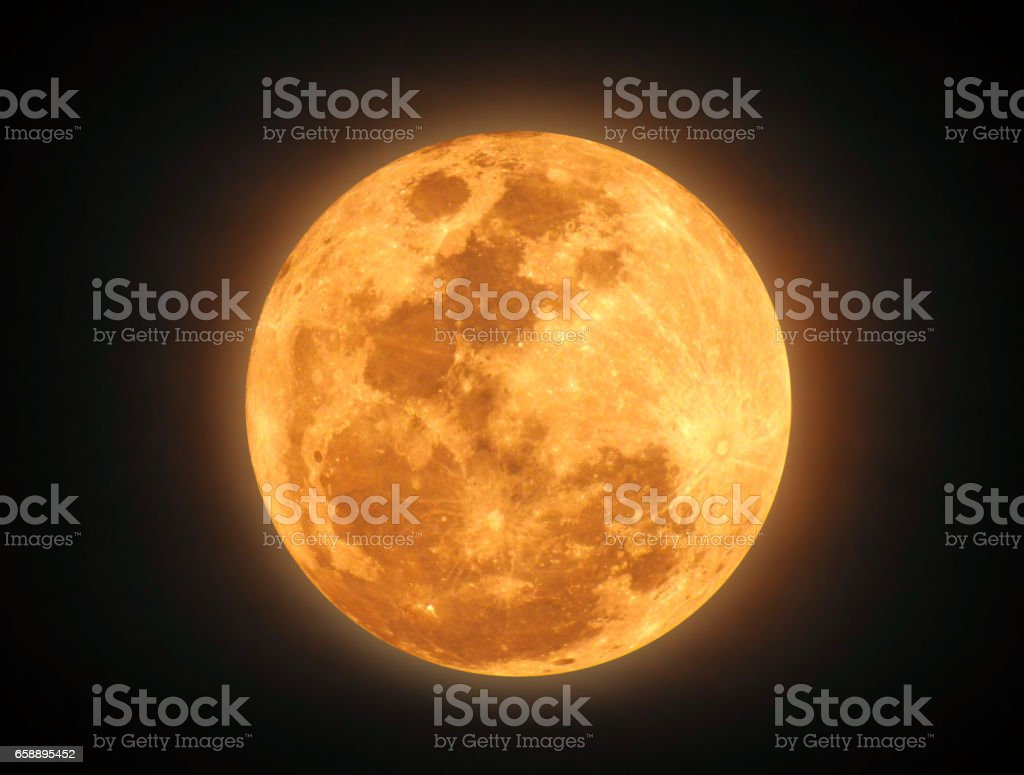 The yellow full moon on black background - Photo